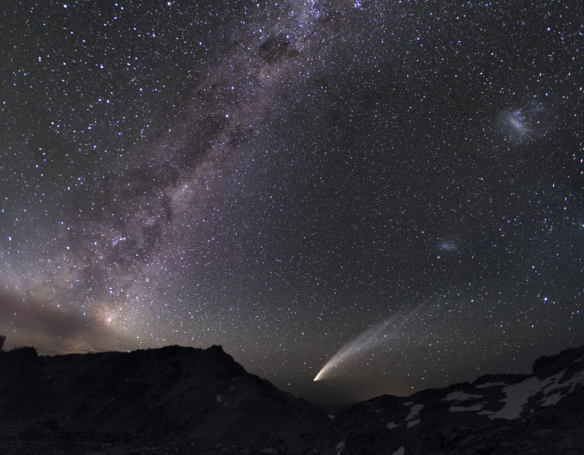 "'Three Galaxies and a Comet' -- ""Diffuse starlight and dark nebulae along the southern Milky Way arc over the horizon."" From Astronomy Picture of the Day http://apod.nasa.gov/apod/ap131020.html"